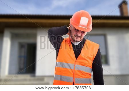Picture Of Young Male Engineer Having Neck Problems