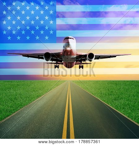 One passenger airplane takes off from a runway. Beautiful blue cloudy sky and sunset background. Grass field around. European Union flag. Travel to America, USA concept