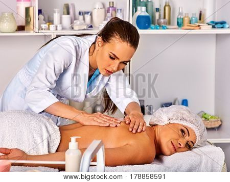 Massage room for therapy deals. Woman therapist making manual therapy back. Hands of masseuse treatment of spinal injuries 40 old client in spa salon. Fright on the face of young masseuse.
