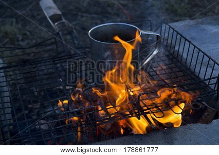 Cup Travel Titan On Fire. Lunch While Traveling In The Wild. The Camping Lifestyle