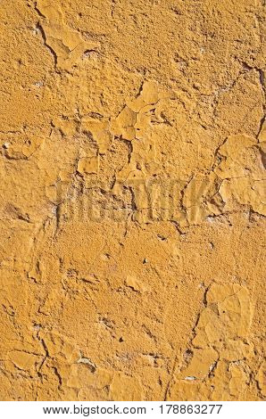 Obsolete grungy yellow background of natural cement or stone old texture as pattern wall