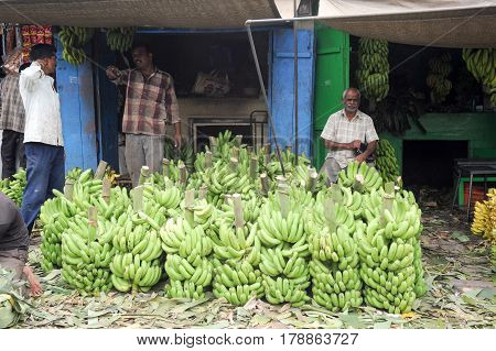 Indian Vendors With Banana Stall In The Devaraja Fruit Market