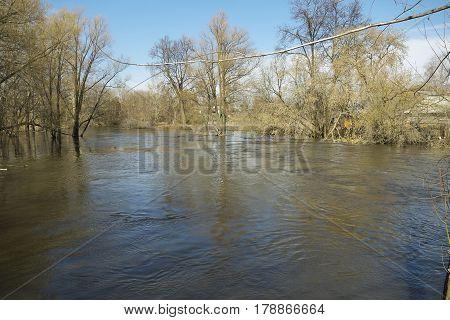 Spring flood in the village river overflow