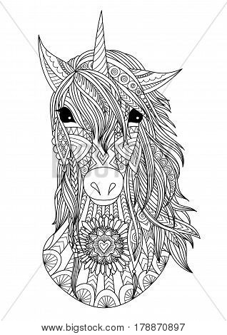 Zendoodle design of unicorn head for t shirt design,design element and adult coloring book page.