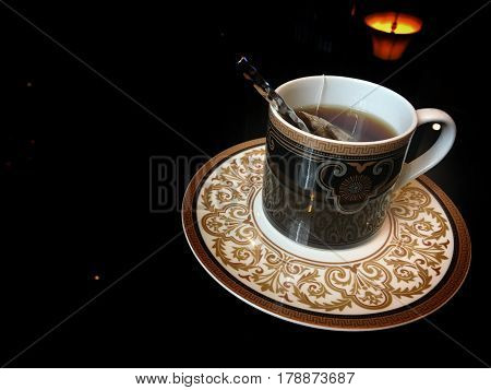 Coffee glass in the glass table in the black room