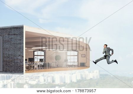 Jumping businessman in office. Mixed media