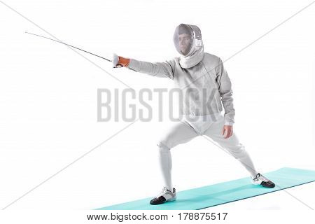 Side View Of Fencer In Uniform Training With Rapier In Hand On White