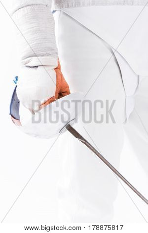 Partial View Of Fencer In Uniform Holding Rapier In Hand On White