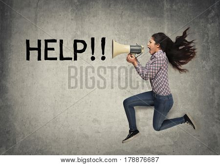 Woman asking for help through a megaphone