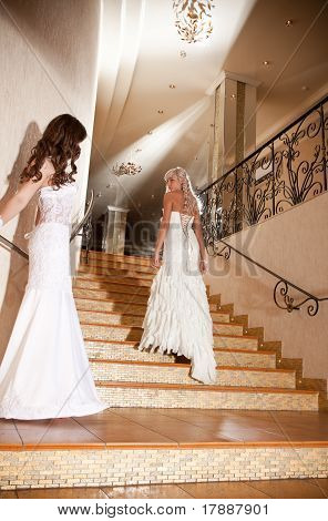Two Girls In A Beautiful Wedding Dress On The Stairs