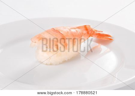 Sushi With Tiger Shrimp On A White Plate On A White Background.