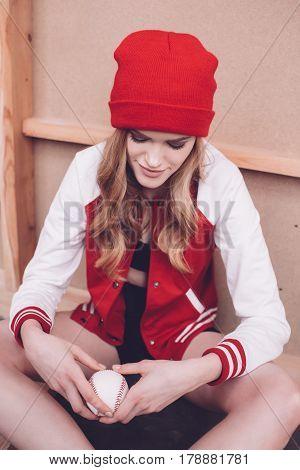 Stylish Hipster Woman In Baseball Jacket With Baseball Ball