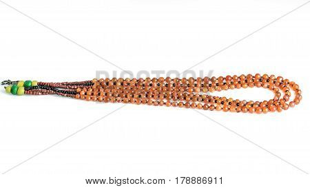 A necklace of old carnelian beads isolated on white background