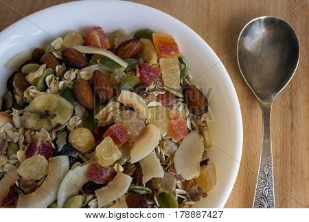 Muesli with dried fruits candied fruits nuts and pumpkin seeds. Concept - healthy breakfast.
