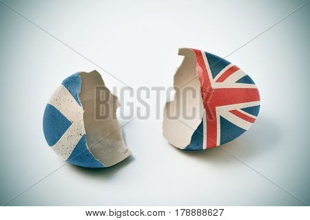 the two halves of a cracked eggshell, one patterned with the flag of Scotland and the other one patterned with the flag of United Kingdom