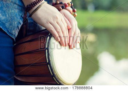 Playing the djembe. Beautiful stylish ethnic picture.