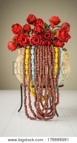Ancient brownish , pastel blue and yellow trade beads in the pot