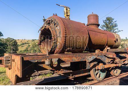 Steam Train old steam locomotives boiler stamped 1951 decaying station graveyard.