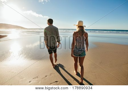 Couple On Beach Holiday In Summertime
