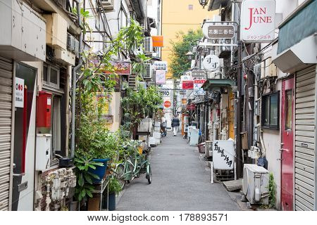 Tokyo, Japan - 19 June 2016: The Golden Gai in Shijuku. District with almost 200 tiny bars in six alleys- a glimpse of old Tokyo. One of few areas not to be rebuilt after earthquake or WW2 damage.