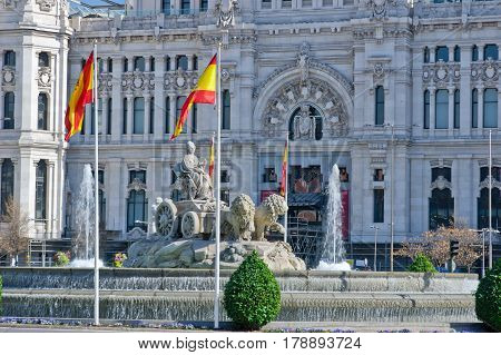 Fountain on Cybele Square (Plaza de Cibeles) with Cybele Palace (Palacio de Cibeles) on background in Madrid Spain