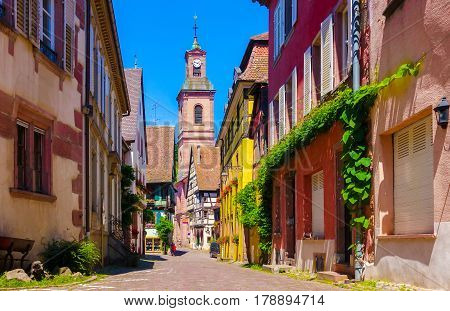 Picturesque street with charming traditional houses in Riquewihr village on the wine route France