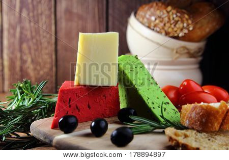 mixed cheeses with olives,rosemary,bread and fresh tomatoes