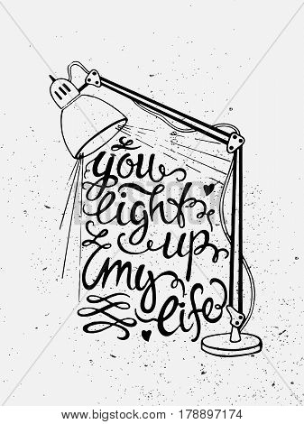 Hand drawn vintage illustration with hand lettering and a lamp isolated on white. You light up my life. Quote. This illustration can be used as a print on t-shirts and bags or as a poster.