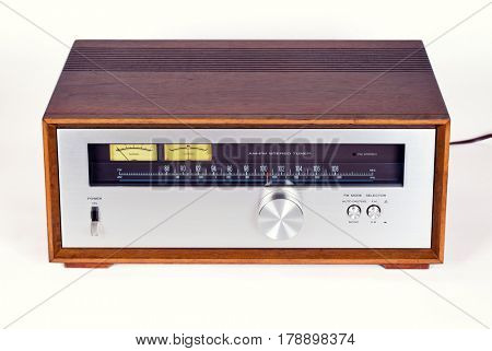 Vintage Stereo Audio Tuner Radio in Wooden cabinet on white background, frontal view