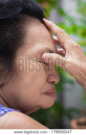 The old woman have cold and headache.