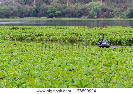 Kanchanaburi, Thailand - March 27, 2017 : Undefined farmer get Fish traps at the lake