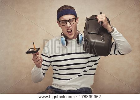 Excited young man enjoying music in his cassette player