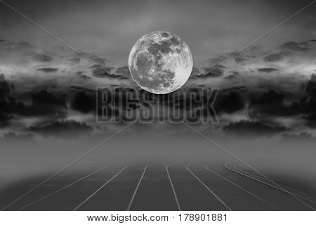 Beauty sky with super moon and silhouette of clouds over racetrack for running. Backstretch or racecourse with foggy. Outdoors in the evening. The moon were NOT furnished by NASA.