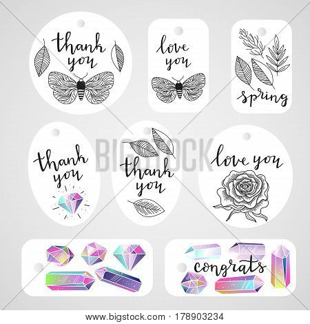 Set of tags with crystals gems leafs butterfly rose flower and handwritten lettering quotes. Black and white natural elements and colorful gems. Ink black text. Vector illustration.