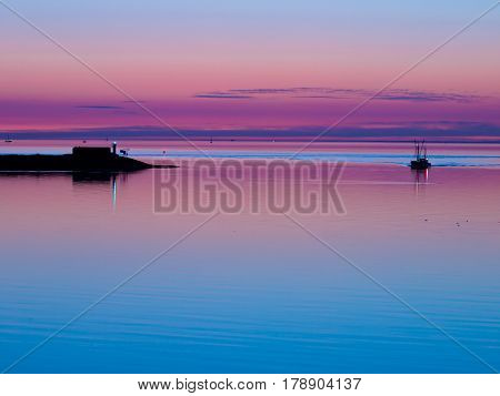 Beautiful Tranquil Sunset over the blue Ocean
