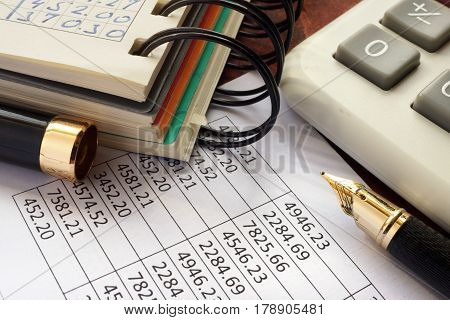 Balance sheet and accounting data on a table.