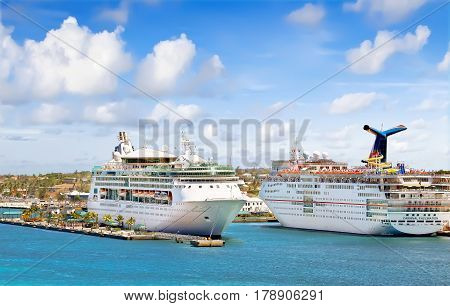 NASSAU, BAHAMAS - APRIL 13, 2015: Royal Caribbean cruise ship Grandeur of the Seas and Carnival Fascination docked at port on the sunny day