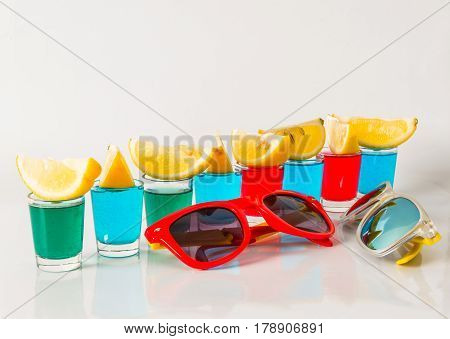 Glasses With Blue, Green And Red Kamikaze, Glamorous Drinks, Mixed Drink Poured Into Shot Glasses, S