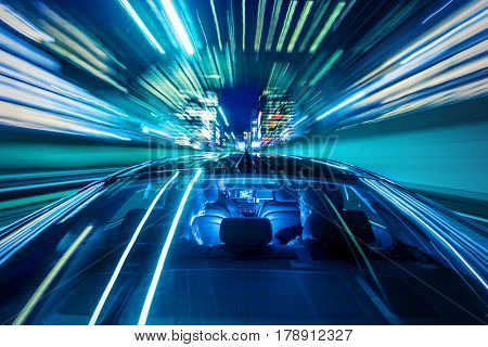 Moving forward, heading for the city life, sitting in the backseat of a car while the cabdriver drives through a tunnel