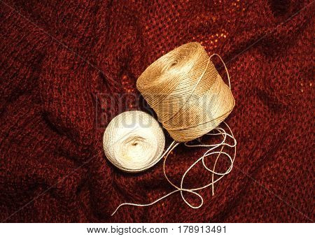 Cotton threads for sewing on a wool sweater work