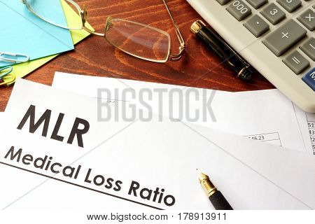 Document with title Medical Loss Ratio (MLR) in an office.