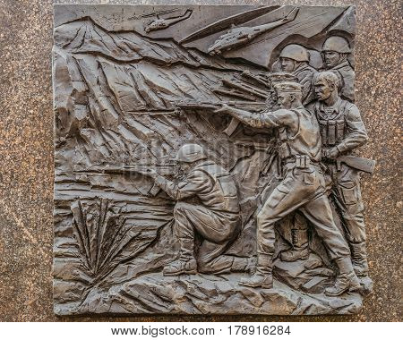 Belgorod Russia -October 08 2016: Historical bas-relief in Belgorod the obelisk of military glory depicting the modern local armed conflicts.