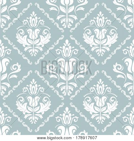 Damask vector classic light blue and white pattern. Seamless abstract background with repeating elements. Orient background