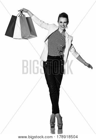 Happy Woman With Shopping Bags Balancing On White Background