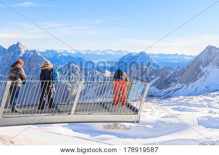 GARMISCH-PARTENKIRCHEN GERMANY - DECEMBER 10 2016: Group of Germany's seniors enjoying fresh air on Zugspitze peak 2962m high. Happy life in European Union Zugspitze in Garmisch Partenkirchen Germany