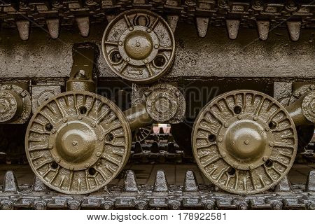 Tracked chassis Soviet heavy tank during the second world war. Tracked chassis with wheels closeup. Artillery WWII.