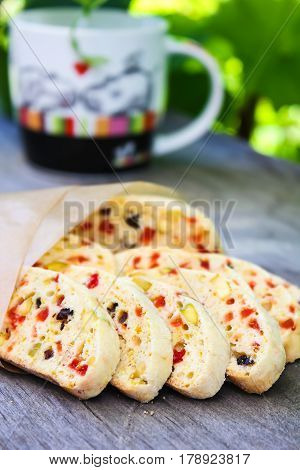 Homemade biscotti cookies with dried cherry and plum and pistachios on a wooden table, selective focus