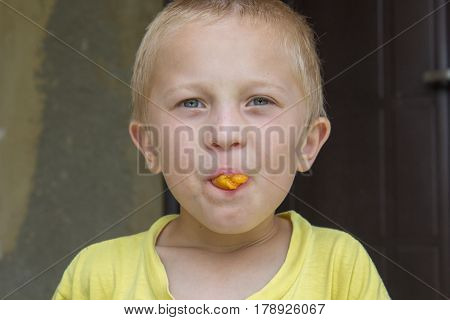 funny gay boy in his mouth holding apricots