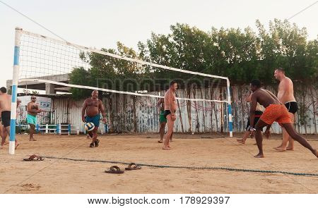 male Caucasians Arabs Africans and playing volleyball on the beach at sunset. Egypt. Hurghada. Golden 5 October 7 2016