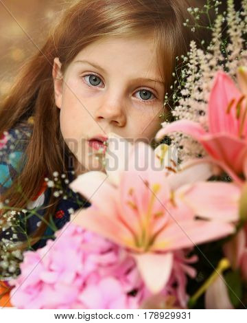 Litle Blond Girl With Lily Bouquet